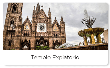 Front view of the Templo expiatorio next to a water fountain