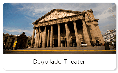 Neoclassical theater with tall columns and marble sculptures