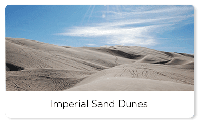 Sand dunes under a blue sky